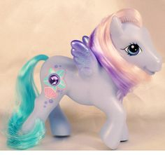 The beautiful AURORA MIST pony was born in March and her favorite color is ocean blue! She loves to enjoy oatmeal cookies and her favorite thing to do is collect seashells! My Little Pony Dolls, New My Little Pony, Vintage My Little Pony, Little Ones, Little Girls, My Little Pony Cupcakes, Cupcake Dolls, Star Darlings, My Little Pony Merchandise