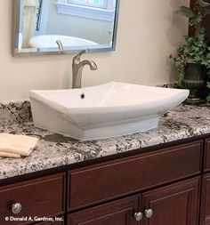 This bathroom gets a modern touch with a countertop sink! The Kenningstone #1166. http://www.dongardner.com/house-plan/1166/the-kenningstone. #Bathroom #HomePlan #HomeDecor