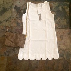 Ivory Scalloped Dress A girl should be two things: classy and fabulous. Stand out with this beautiful ivory dress  ➖ Fits true to size.. ➖ Small - 0/2-3/4, Medium - 5/6-7/8, Large 8/10-11/12 ➖ Fabric: 100% Polyester ➖ Sizes: Small, Medium, Large  ➖ Please do not purchase this listing. Comment below & I will create a custom listing for you!   10% off if bundled! Dresses Mini