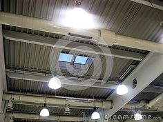 Ceiling lighting and windows at supermarket