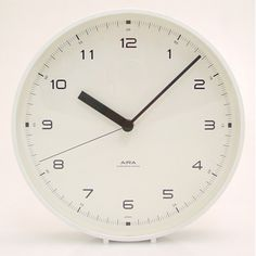 Clean-lined simplicity is a hallmark of the very best Japanese design and this handsome wall clock is no exception. The finely shaped aluminum body surrounds an easy to read face that features a continuous sweep hand. The neutral design makes it a welcome addition to both commercial and residential settings. If wall space is at a premium, display it on a table or shelf—it comes with its own removable stand for this purpose. Japanese quartz movement. Requires one AA battery (included).
