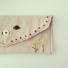 embroidered coin case for we work you shop.