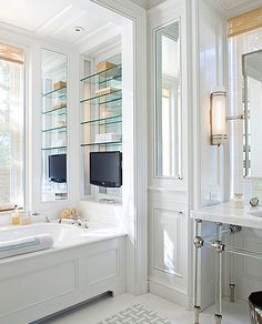 Mirrored built in with glass shelves, mirrored cabinet door...great bathroom inspiration!