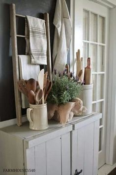 Like the idea of this small ladder and displaying vintage/favorite linens. Vintage Linens and Wooden Utensils - displayed in the kitchen on a rustic sideboard - via FARMHOUSE Farmhouse Friday ~ Farmhouse Kitchen Primitive Kitchen, Farmhouse Kitchen Decor, Farmhouse Design, Rustic Farmhouse, Farmhouse Style, Kitchen Vignettes, French Farmhouse, Primitive Decor, Kitchen Display