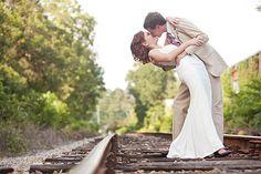 Heart Love Weddings http://www.heartloveweddings.com/wp-content/uploads/2012/03/bride-and-groom-portraits-dip-kiss-on-the-train-tracks-Ashley-Daniell-Photography.jpg