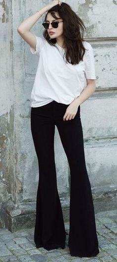 white tee. black flare jeans.