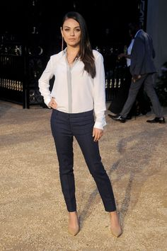 Mila Kunis made a gorgeous appearance at Burberry's event in LA, showing off her chic style while posing for pictures.