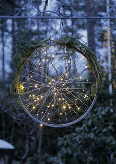 A bicycle wheel decorated as a wreath, cool!
