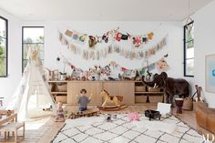 Fashion Designer Jenni Kayne's Residence in Beverly Hills Bohemian modern kids playroom – Moroccan rug, white walls, black steel windows, mid century storage – This room can mature with your children and their hobbies. Blog Da Carlota, Childrens Room, Bohemian Kids, Bohemian Style, Bohemian Homes, Modern Bohemian, Bohemian Decor, Los Angeles Homes, Modern Kids