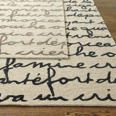 Rugs with cursive script.