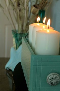 cast-off drawer turned into eye-catching candle display.  old sewing machine drawers would be perfect for this project.
