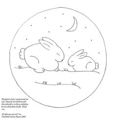 Bunnies. This embroidery would be cute left on the hoop and hung in a nursery.