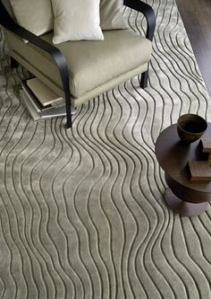 A wave-like design milled into the rug CURVE.