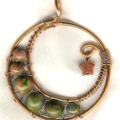 One of my pieces! This is called a Crescent Moon pendant, with Unakite (green) and Goldstone (star). Look for more of my jewelry at the Copper Wire Jewelry website, under Orion Lyonesse.