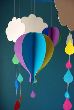 hot air balloon mobile- could use same concept for trees or clouds or forest theme