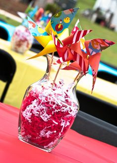 Pinwheel Centerpieces~ i have these almost exact vases! maybe turn them different colors and add glitter