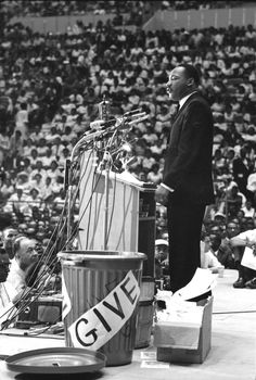 Martin Luther King, Jr. addresses a rally in Detroit, 1963.