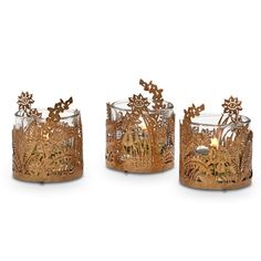 """GOLDEN FROND VOTIVE TRIO  Item #:  P92646 A delicate palm leaf motif brings the outdoors in. Pair this set of three holders with a Signature fragrance for the perfect seasonal bouquet. Includes glass cups for use with votives or tealights, sold separately. 2¾""""h 7 cm h, 2¼""""w 6 cm w"""