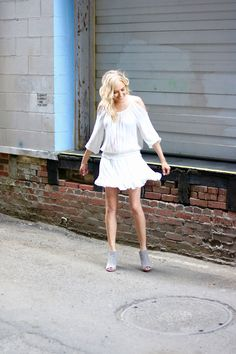 A flirty cold shoulder white dress, grey suede slip on heels, and tousled waves. #ootd #whitedress #lwd