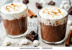 hot dark chocolate with whipped cream, cinnamon and salted caramel. the toning. selective focus