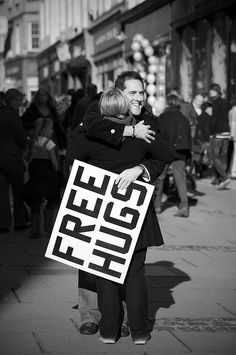 The Free Hugs Campaign is a social movement involving individuals who offer hugs to strangers in public places.The hugs are meant to be random acts of kindness—selfless acts performed just to make others feel better. Need A Hug, Love Hug, I Smile, Make You Smile, Hug Pictures, Happy Pictures, The Embrace, A Course In Miracles, Free Hugs