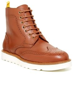 $198, Brown Leather Brogue Boots: Wesc Bo Brogue Boot. Sold by Nordstrom Rack. Click for more info: https://lookastic.com/men/shop_items/151010/redirect