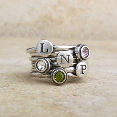 Initial Ring Stack Alphabet Stamped Band in by nelleandlizzy, $16.00 with birthstones Zander initials of mommy, daddy, & p