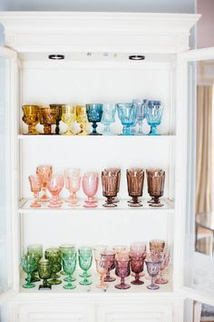 rainbow of vintage glassware, holiday table decor colorful glass display - centered by design