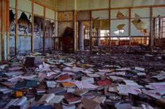 Abandoned books in a Detroit Warehouse.   via Reddit.com, user Andewz111.