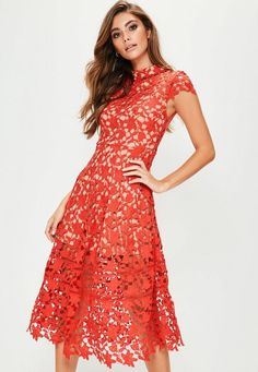 This red dress will give you knock-out style! With it's chic contrasting red lace and black underlay, midi length and short sleeves. One for that special occasion.