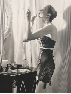 I like the photos where the girl is putting on her make up. They are erotic somehow.
