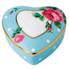 Perfect for your delicate little trinkets, this luxury fine china box from Royal Albert comes in a heart shape. It comes in blue with a spotted rose design and elegant gold trims.