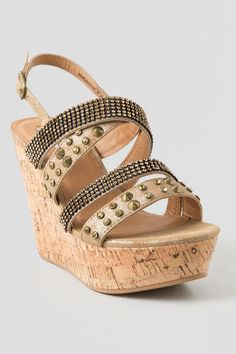 This shoe features multiple straps glitterized with rhinestone and stud embellisments.  Pair this wedge with your favorite sundress for the perfect spring or summer outfit!