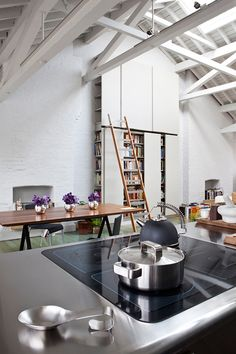 Super-high storage with rolling-ladder access at the home of Anissa Helou, a London-based food writer