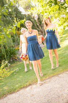 Blue bridesmaids dresses and bright florals from Zoe & Tim's Wedding.