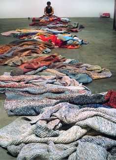 """Canadian artist Germaine Koh's knitted piece """"Knitwork"""", begun in 1992. It is a constantly developing work made from hundreds of unraveled sweaters that are re-knit by hand into a continuously growing object."""