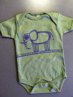 "The Organic ""Elephant"" Onsie is the perfect gift for any bundle of joy in our life! We design these for our own baby boy Sequoia!     Made In America  100% Organic Cotton  12 Emerg. Meals Fed/Elephant Onsie Sold  Vegan  Sweat-Shop-Free  Sizes: 3/6 Months, 6/12 Months, 12/18 Months, 18/24 Months"