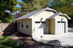 Quaint carriage house two car garage. Photo and copyright by Renovation Design Group.