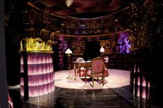 The office of Dolores Umbridge in the Ministry of Magic is terrifying and entrancing in equal measures - just like its proprietor. With wall plates that would please Miss Marple and purple shiny surfaces that would have most certainly been on Liberace's wish list, it's an ideal example of decadent chic.