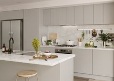 white pepper doors in modern profile with mayonella benchtop and splashback | kaboodle kitchen