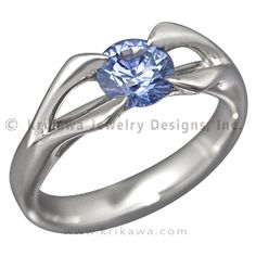 Carved Branch Unique Engagement ring with Blue Sapphire - Be reminded of your eternal union and its growth every time you gaze at your hand. Two sets of branches come together at the top of this artistic ring. This airy but substantial design accommodates round brilliant cut diamonds or sapphires. Like every Krikawa ring, it is handmade with proportions to precisely fit your center gemstone. Envision your Carved Branch Engagement Ring in your favorite precious metal, with your preferred…
