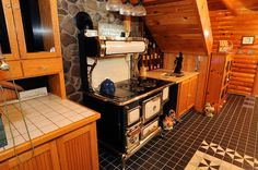 Vintage stove in a log cabin kitchen in Chittenango