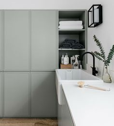 Organic modern laundry room with light gray cabinets, stone tile floor, and built in linen closet with black accents. Add this to your laundry room inspiration board! Laundry Room Design, Laundry In Bathroom, Laundry Cupboard, Linen Cupboard, Design Bathroom, Home Decor Kitchen, Home Kitchens, Kitchen Furniture, Wood Furniture