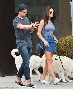 Preppy pair: Meanwhile, the 30-year-old dog lover beat the 80F-degree heat in her sleevele...