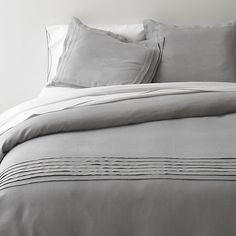 Pietra Bed Linens in All Decorative Bedding   Crate and Barrel. Even in my fantasy shopping I consider my husband's hatred of lepord prints and stick with conservative. Sigh. Marriage. Hey weve hung in there almost 7 years...it's time to go shop for some animal print decor....