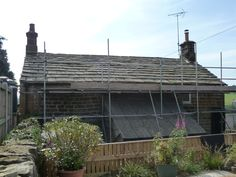 Strip and recover of stone slate Yorkshire cottage by Derry Construction Ltd. 2012