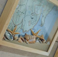 Coastal Shadow Box - Copy and enlarge a map of the area you visited. Cut it to fit inside a shadow box, and use spray-mount to affix it to the back of the box. Fill the box with sand and shells you collected. You'll be transported to paradise every time you see it. DIY Tip: Make sure sand won't spill from the seams of the shadow box. If necessary, run a thin bead of wood glue along the seams to make it leakproof. (Original Source Unknown)