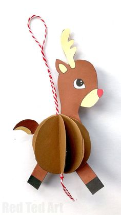 Red Ted Art's Paper Reindeer Ornament. How cute are these easy Reindeer Baubles? Super fun and easy to make. Choose from different colours.. and turn them into Paper Ornaments or Pop Up Christmas Cards! Adorable. #Reindeer #Christmas #Reindeerornament #ornament #diy #printables #baubles
