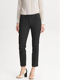 Like the idea of black cropped dressy slacks with heels or flats - especially with the bright orange trench as a blazer.