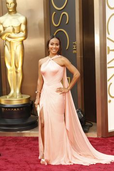 Jada Pinkett Smith Oscars 2014 The star stunned in a custom-designed petal pink silk halter gown by Atelier Versace alongside her husband, Will Smith.